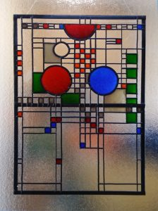 Using Adhesive lead in Glass Painting.